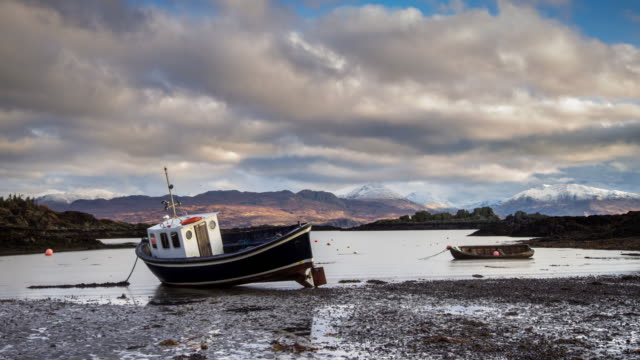 boats at low tide on skye - time lapse - moored stock videos & royalty-free footage