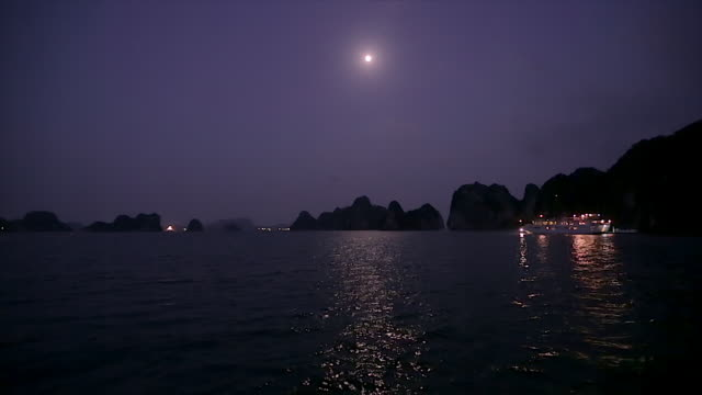 WS Boats at night in Ha Long Bay / Vietnam