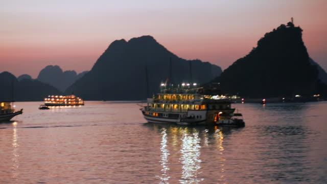 boats at night in ha long bay, vietnam - halong bay stock videos and b-roll footage