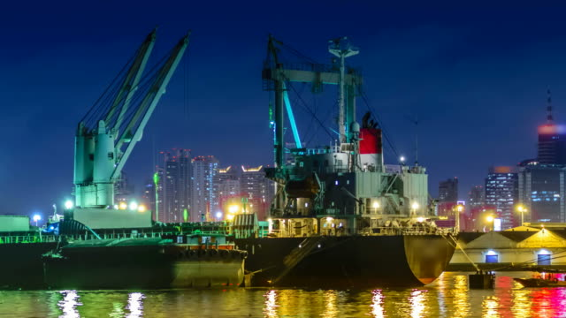 boats carrying sand work at nigh - barge stock videos & royalty-free footage
