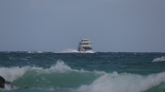 Boats crossing path on ocean