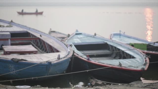 boats docked on the ganges in varanasi - moor stock videos and b-roll footage