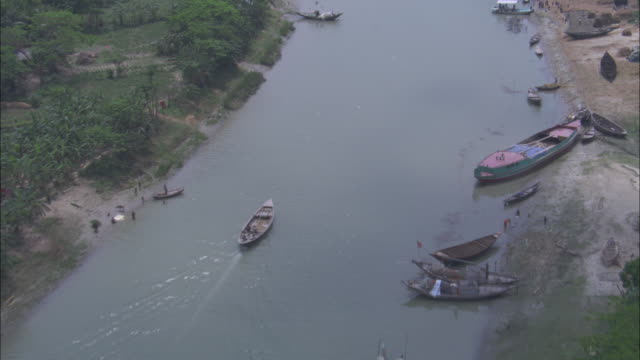 boats float and travel near the mouth of the ganges river. available in hd. - bangladeshi culture stock videos & royalty-free footage