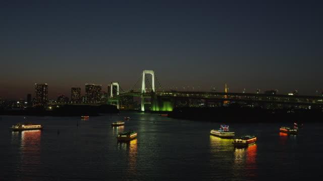 boats floating at tokyo bay, odaiba, tokyo, japan - tokyo bay stock videos & royalty-free footage