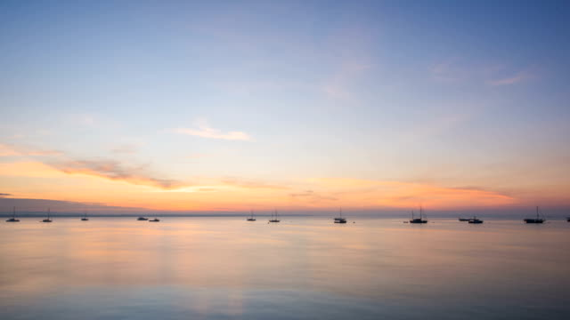 boats floating on the ocean at sunrise / darwin, australia - sailing stock videos & royalty-free footage