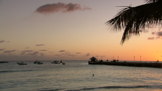 WS PAN Boats floating on the sea at sunset / Brightown, Barbados