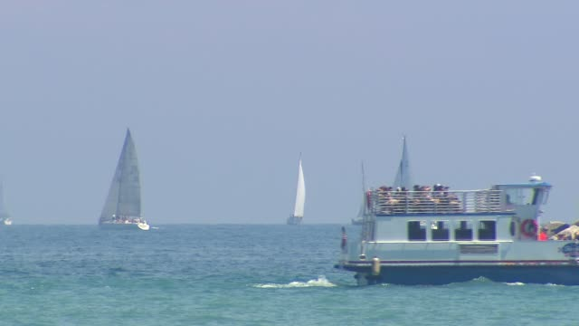 boats glide by on lake michigan near navy pier on july 4 2014 in chicago illinois - lake michigan stock videos & royalty-free footage