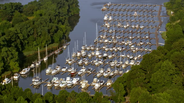 AERIAL Boats in a small marina in sunshine