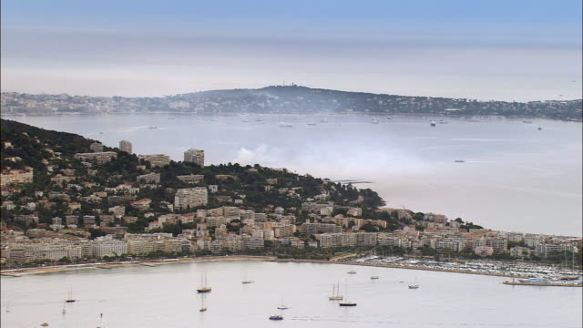 AERIAL Boats in bay with view of Cap Ferrat in morning/ Cannes, France