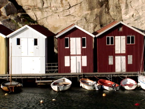 Boats in front of fishing-huts Bohuslan Sweden.