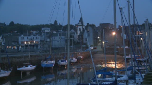 ms, boats in harbor at dusk, south queensferry, edinburgh, scotland, united kingdom - fluss firth of forth stock-videos und b-roll-filmmaterial