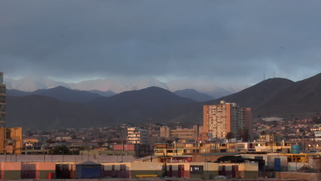 ws zo boats in harbor with cityscape and mountains in background, sunset, antofagasta, chile - antofagasta region stock videos and b-roll footage