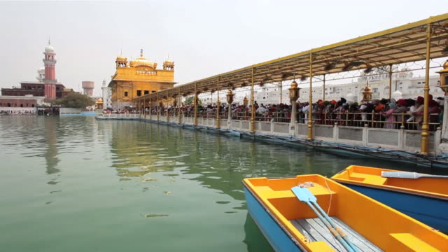 MS Boats in pond of Golden Temple (Sikh temple) / Amritsar, Punjab, India