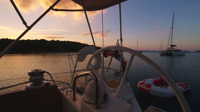 ws boats in the bay at sunset - helm stock videos and b-roll footage