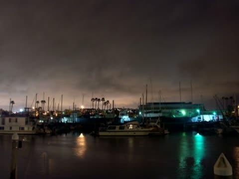 boats moored at a harbor - schiffsmast stock-videos und b-roll-filmmaterial