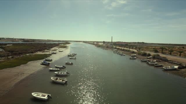 ws ha boats moored at gilao river / tavira, algarve, portugal - algarve stock-videos und b-roll-filmmaterial