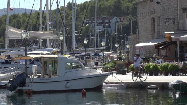 Boats moored at promenade in marina of Vrboska