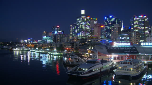 T/L WS Boats moored by Sydney Aquarium at Darling Harbour at night / Sydney, New South Wales, Australia