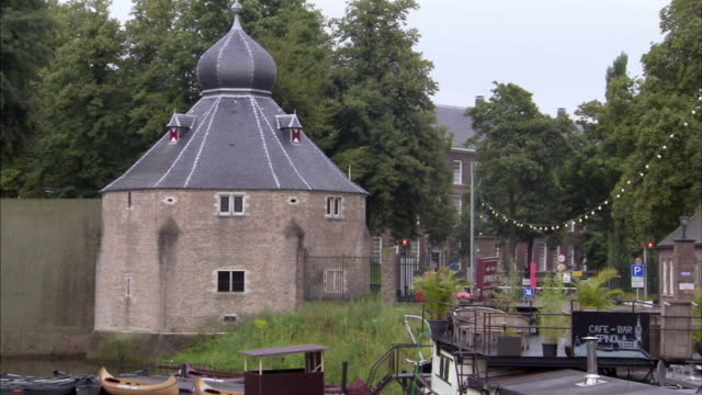 ms, zo, boats moored in moat, breda, netherlands - moat stock videos and b-roll footage
