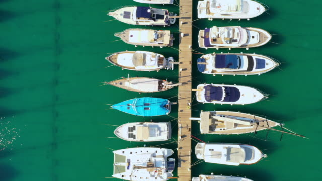 aerial boats moored in the marina - moored stock videos & royalty-free footage