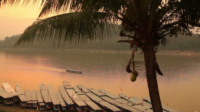 ws boats moored on mekong river at sunset / luang prabang, laos - laos stock videos and b-roll footage