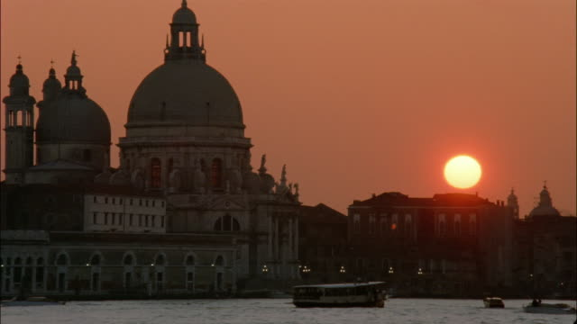 Boats move along St. Mark's Basin in front of the Salute church in Venice, Italy.