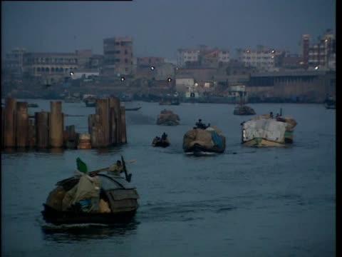 boats move slowly along a river - bangladesh stock videos & royalty-free footage