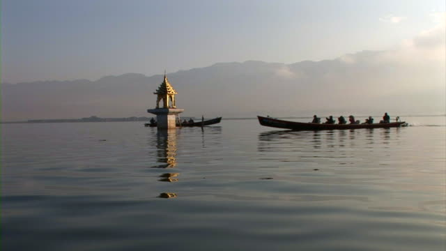 Boats moving in Inle Lake, Myanmar