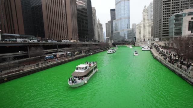boats navigate the chicago river shortly after it was dyed green in celebration of st patrick's day on march 17 2018 in chicago illinois dyeing the... - river green stock videos & royalty-free footage