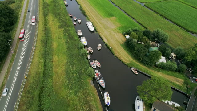 boats on canal and fields - utrecht stock videos & royalty-free footage