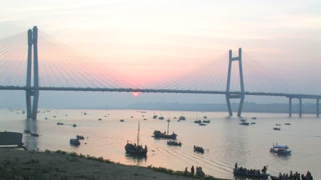 WS, HA, Boats on Ganges river under 2nd Yamuna Bridge at sunrise, Allahabad, Uttar Pradesh, India