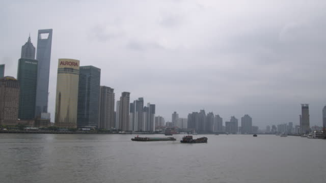WS Boats on Huangpu River with skyscrapers in background / Shanghai, China