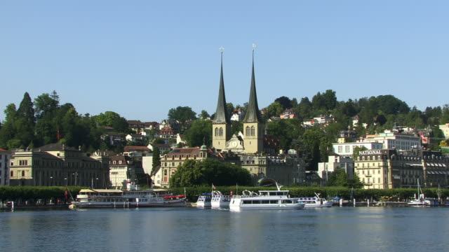 ms, boats on lake lucerne and st. leodegar church, lucerne, switzerland - 17th century style stock videos & royalty-free footage