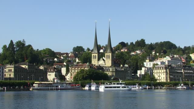 MS, Boats on Lake Lucerne and St. Leodegar church, Lucerne, Switzerland