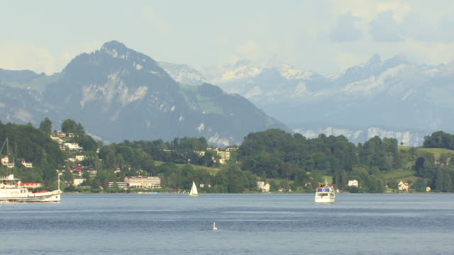 ws, boats on lake lucerne with mountains in background lucerne, switzerland - lake lucerne stock videos & royalty-free footage