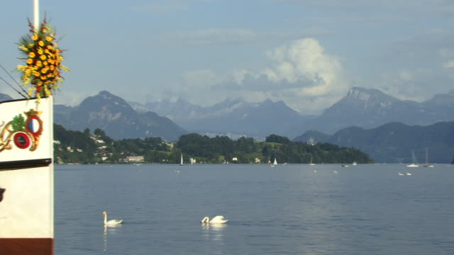 zo, ws, boats on lake lucerne with mountains in background lucerne, switzerland - lake lucerne stock videos & royalty-free footage