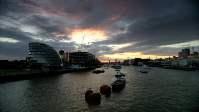 WS, Boats on river Thames and City Hall at sunset, London, England