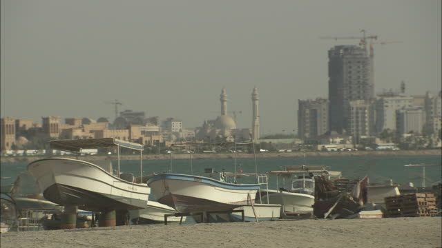 boats on stands line the bay of the bahrain river. - bay of water stock videos & royalty-free footage