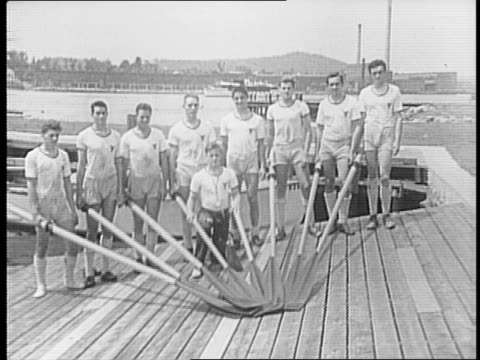 vídeos y material grabado en eventos de stock de boats on thames river in connecticut / young man holding stack of harvard pendants / harvard rowing team posed with oars / yale rowing team posed... - anclado