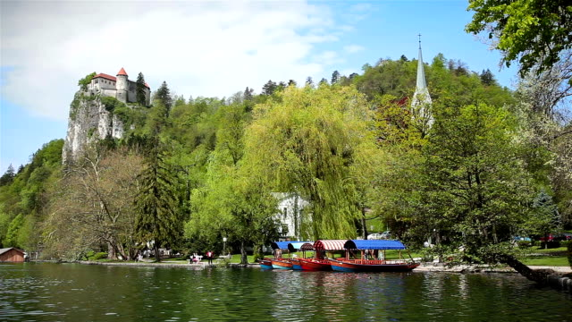 hd: boats on the lake - lake bled stock videos & royalty-free footage