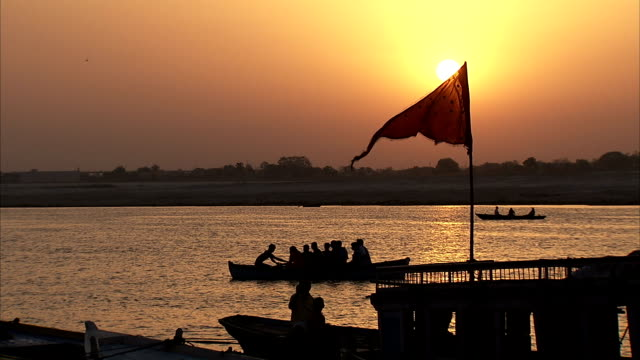 Boats on the River Ganges at sunset.