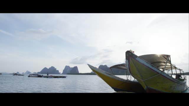 vídeos de stock, filmes e b-roll de boats on the sea in khao sok national park - formato letterbox
