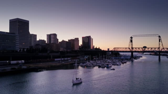 boats on the thea foss waterway at dusk - aerial view - washington state stock videos & royalty-free footage