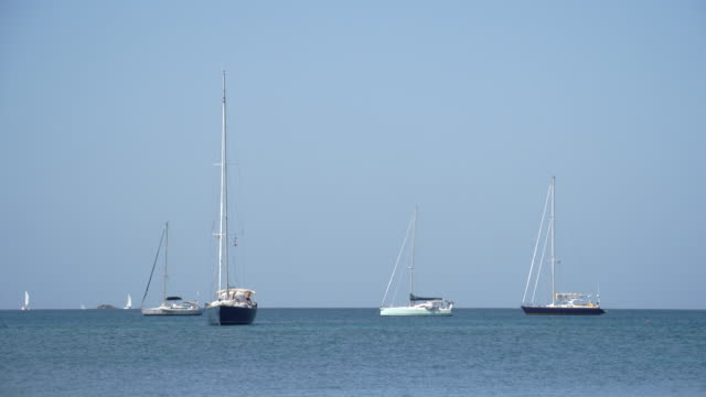 boats out at sea / st lucia, caribbean - saint lucia stock-videos und b-roll-filmmaterial