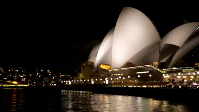 Boats pass crowded Sydney Opera House