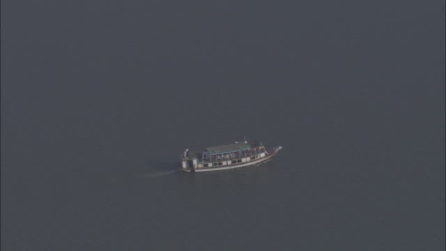 boats pass each other on the ganges in sundarbans bangladesh. available in hd. - other stock videos & royalty-free footage