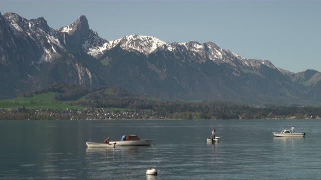 ws boats passing by thun lake  / oberhofen, bernese oberland, switzerlan - lake thun stock videos and b-roll footage