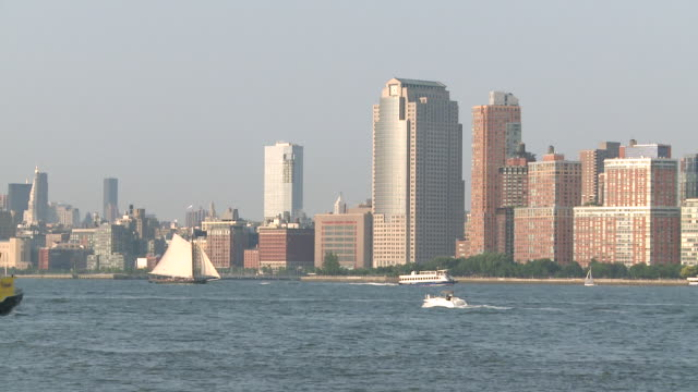 ws boats passing on hudson river with view of downtown manhattan / jersey city, new jersey, united states - five objects stock videos and b-roll footage