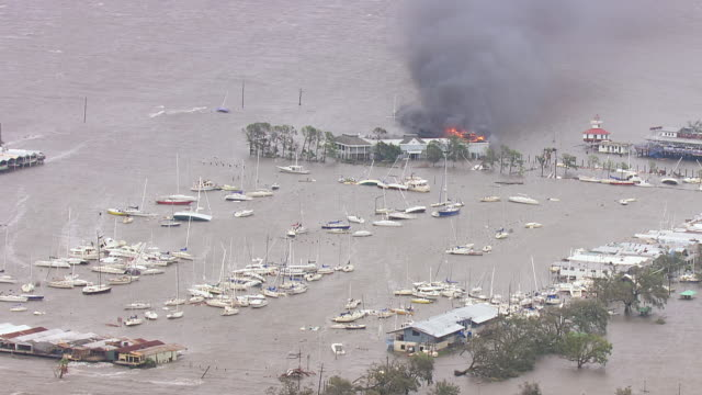 Boats piled up in Lake Pontchartrain and yacht club on fire / United States