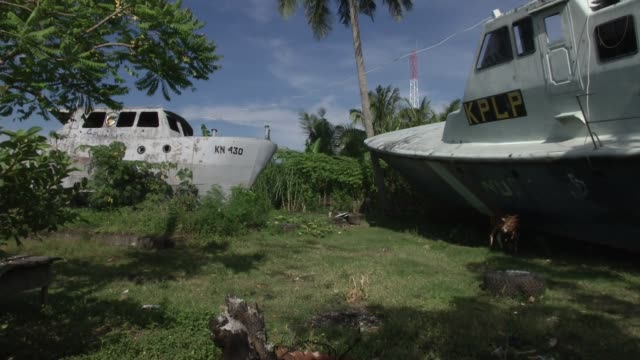 boats rest near homes that washed inland during the 2004 tsunami in banda aceh indonesia - 2004 stock videos & royalty-free footage